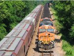 110718010 Westbound BNSF Grain Train Meets Eastbound Coal Train (COLX)