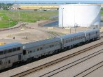 110819022 Eastbound AMTK 8 passes BNSF Northtown Yard with 3 business cars on back