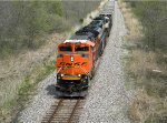 BNSF 9352 Leads a empty GRDA Coal out of town