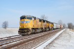 Charging south into the countryside is Union Pacific 4058 with a mix of freight