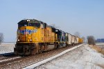 Union Pacific 4700 takes the freight south on a sunny morning