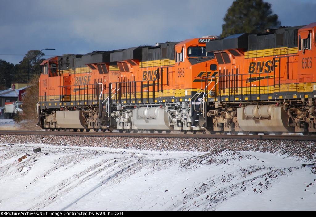 BNSF 7863 leads two ES44C4's BNSF 6648 and BNSF 6606 westward through snow covered Flagstaff, Az.