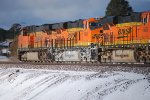 BNSF 7863 leads two ES44C4's BNSF 6648 and BNSF 6606 westward through snow covered Flagstaff, Az.