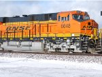 The Swoosh BNSF logo stands out in this sunlight snow shot of BNSF 6648 as she rolls west.