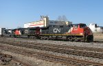 CN 2637 leading NS 210 northbound at Spring