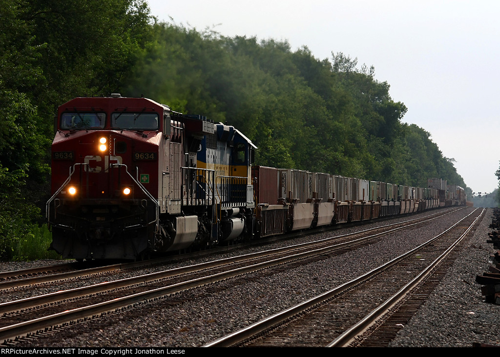 CP 9634 leads 23T west