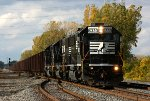 A trio of consecutively numbered SD40E's (6333, 6332 and 6331) lead a Herzog ballast train east at CP Vickers