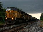 Under threatening skies, K683 rolls west behind UP power