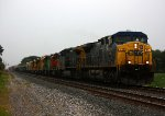 With the rain right on it's heels, Q368 heads east with 5 BNSF Geeps on their way to LTEX