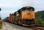CSX 4838 leads Q501 slowly east across the diamonds while CN does trackwork