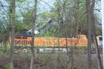 Bad day for remote control CSX 8220.  It ran thru a buffer and down an embankment missing BNSF 5288 (Q541) by a two feet