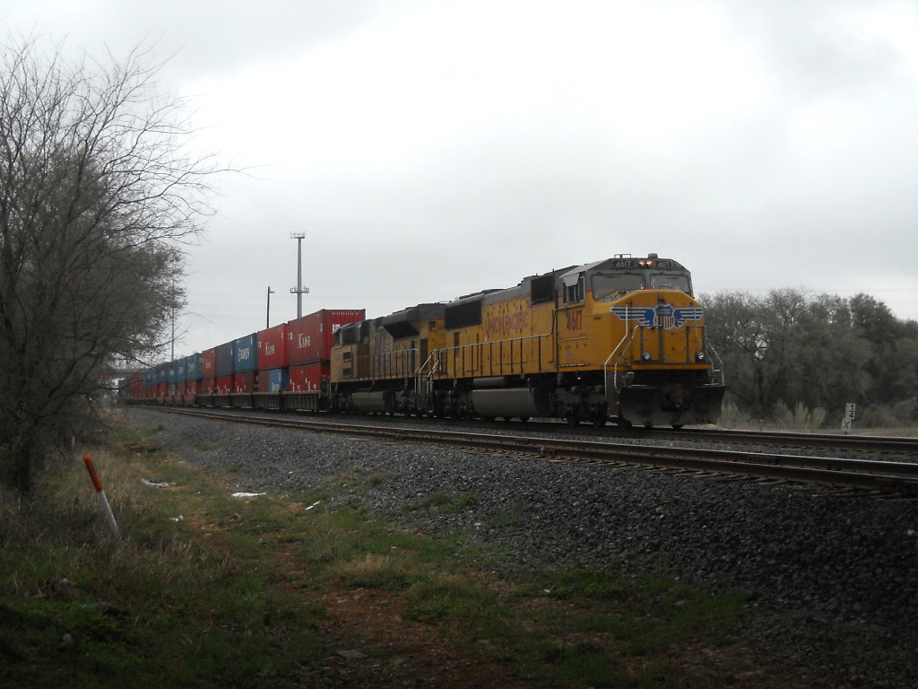 UP 4617  16Mar2011  Riding the rear of NB Train #5478 with stacks approaching the diamond