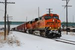 BNSF 7543 goes north with the MADGAL train of mixed freight