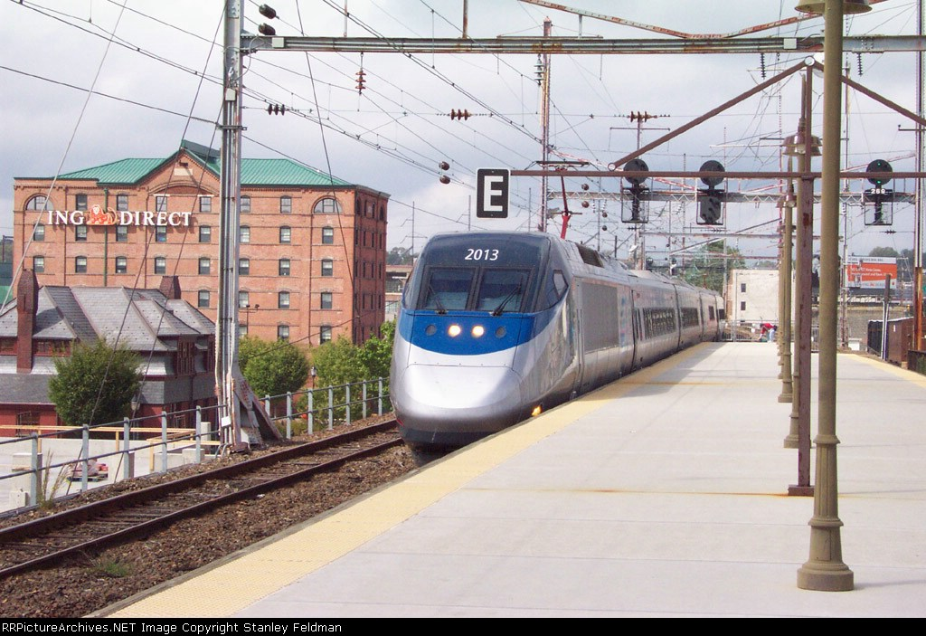 Acela Power Car 2013 leads a North (east) bound Acela Express into Wilmington Station. 9/27/03