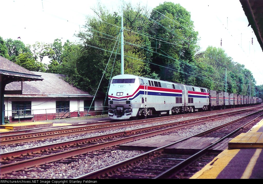 AMTK P42-DC 60 leads Train 43 past Merion Station. 5/16/1999
