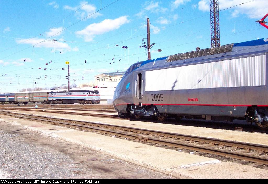 Amtrak E-60 602 Passes Acela Power Car 2005 at 30th Street Station, Philadelphia Pennsylannia.
