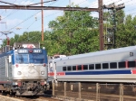 AMTK AEM-7  927  blasts past a stopped Septa Push-Pull Train.  9/9/2005