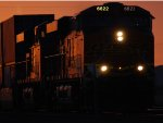 A Zoom in shot of BNSF 6622 as she comes out of a Brilliant California Dusk/Sunset as she leads the Z LAC-CHI Train eastbound for a Crew Swap at THE BNSF Barstow yard Steps.