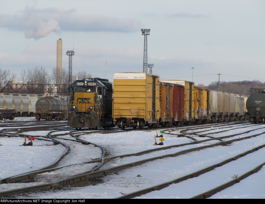 CSX 6083 sits tied down in 12 Track at the west end