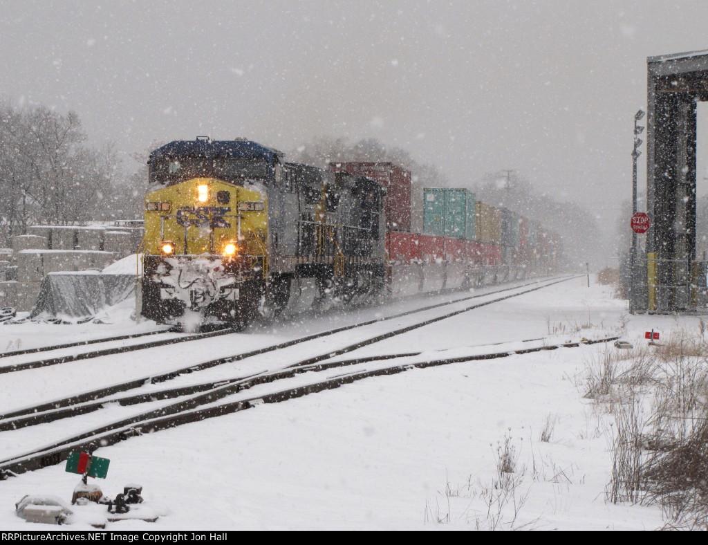 Q196-13 rolls east through the heavy lake effect snow