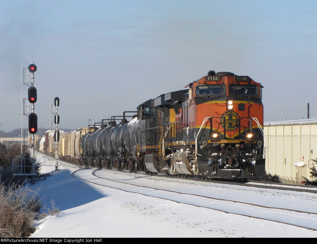 With an ambient temperature of -2 F, BNSF 1114 leads Q334-23 up the hill