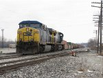 CSX 319 comes to a stop short of Lamar to await a signal to go west with Q195