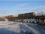Q334-09 crosses the frozen Thornapple River