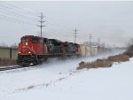 CN 8863 kicks up the fresh dusting of snow as it heads east with Q334-13