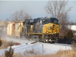 Kicking up a thin cloud of snow, Q334-30 heads east past the old Steelcase Spur