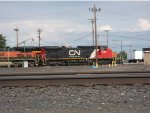CN 2143, a former BNSF/ATSF unit finds herself among former siblings and on familiar turf
