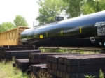 GATX 202667 Tank Car (looking new i might add) behind a Centerbeam Flatcar