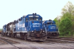 PRR 3058 GP-40-2 and PRR 2904 GP-38, both still in Conrail Quality Paint at Abrams Yard.