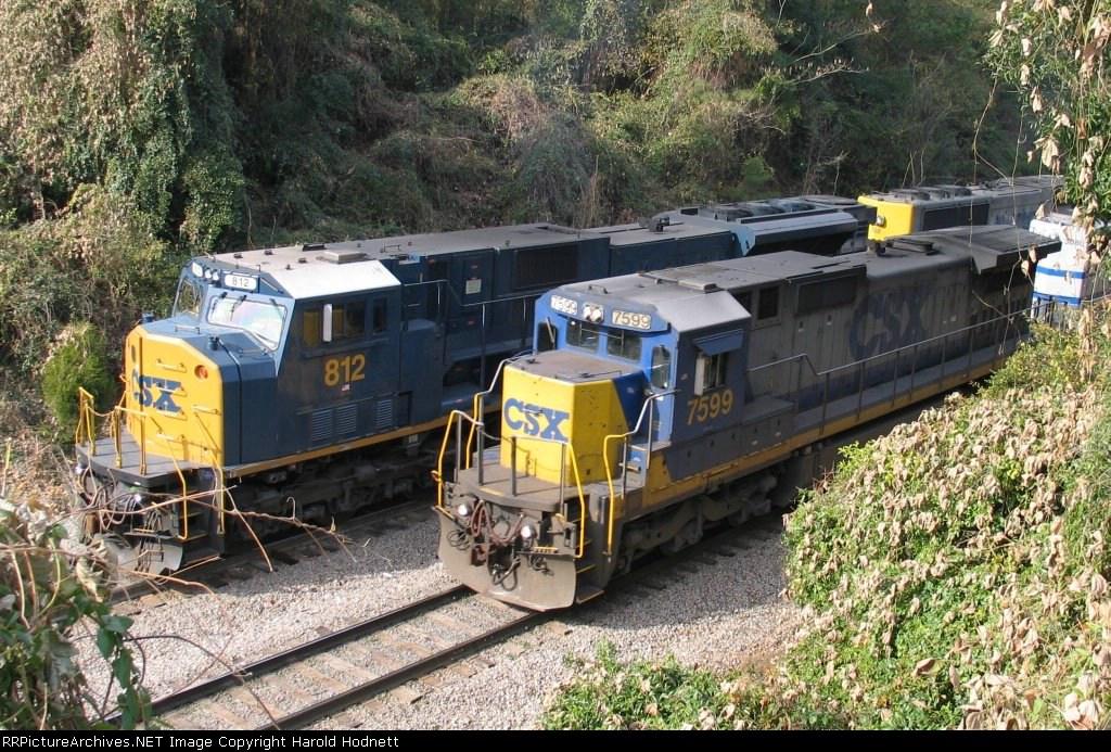 CSX 7599 leads a train past another CSX train