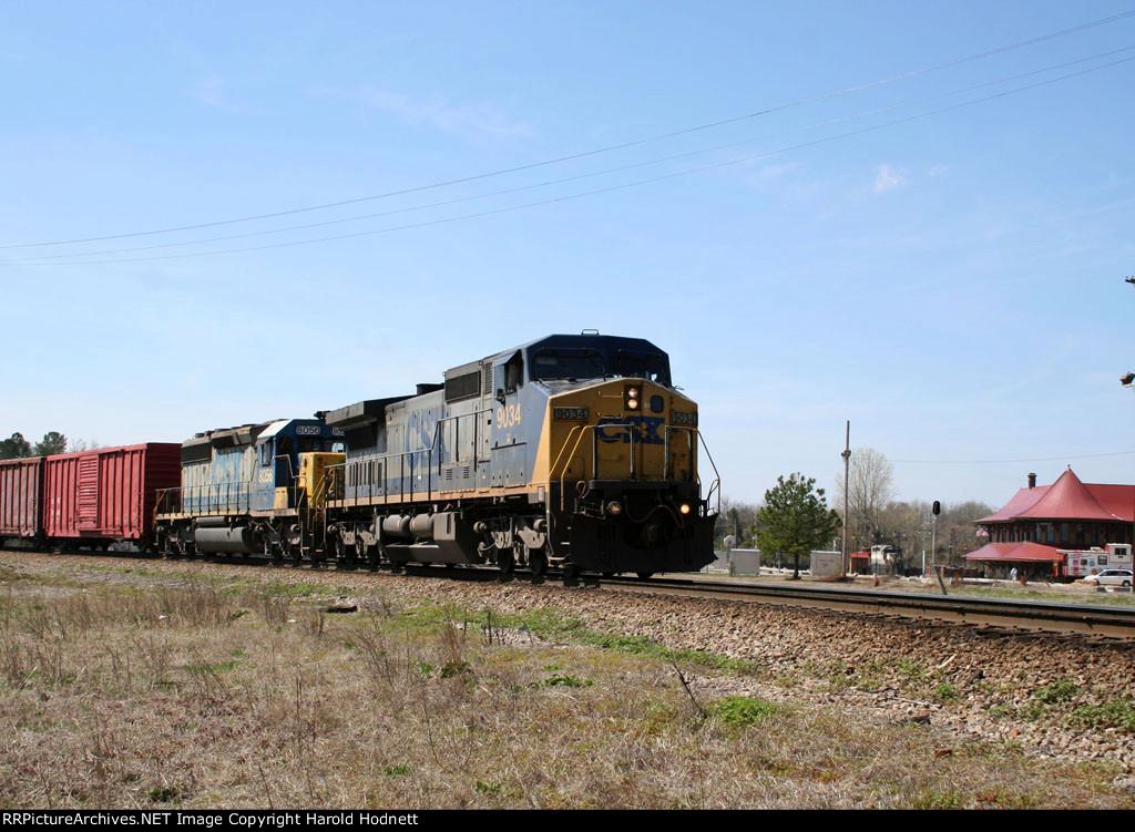 CSX 9034 & 8056 lead a train towards the yard