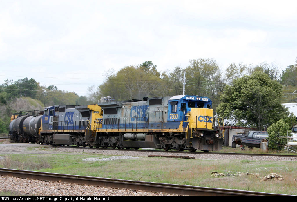 CSX 7500 & 7809 lead a train towards the yard