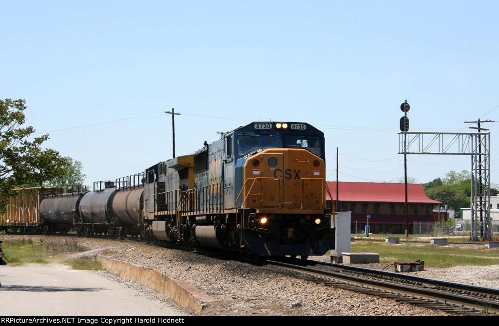CSX 8730 leads a train towards the yard