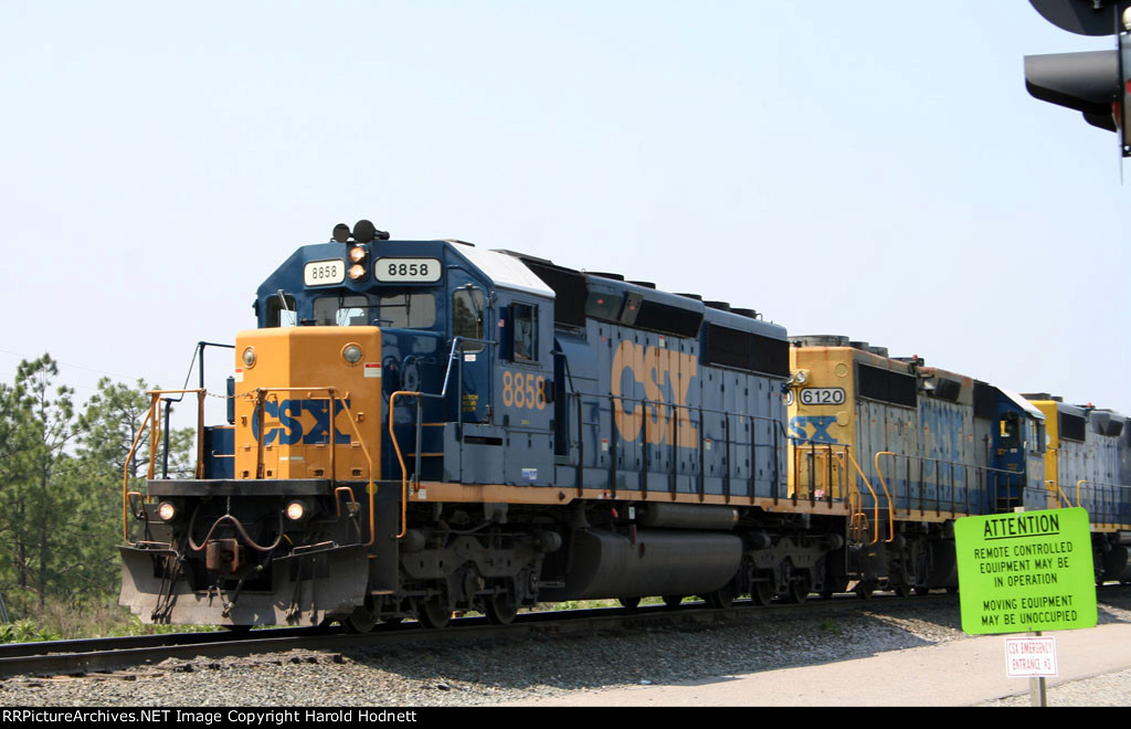 CSX 8858 leads a train northbound