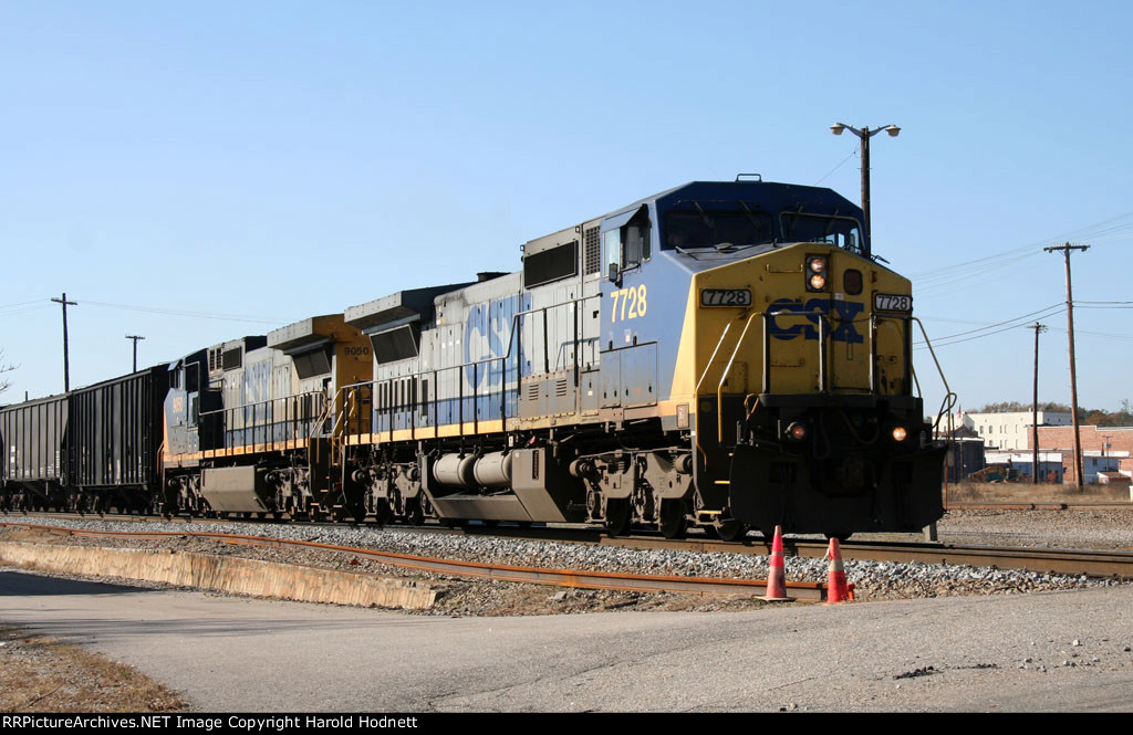 CSX 7728 & 9050 lead a train towards the yard