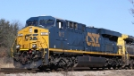CSX 815 leads train Q493 out of the yard