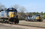 CSX 7885 heads towards the yard while a pair of diesels run the wye
