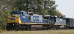 CSX 7668 leads a lease unit and train Q669 westbound