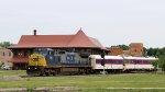 CSX 7361 leads train W009-18 across the diamonds