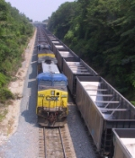 CSX 269 leads a loaded coal train past an empty coal train