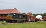 CSX 669 leads train X990-12 across the diamonds