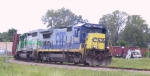 CSX 5948 leads a lease unit into the yard from the west