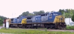 CSX 7745 & 7664 lead a train from the west into the yard