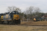 CSX 6350 runs the wye with another unit while a colorful train heads for the yard