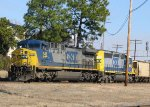 CSX 548 & 8818 lead a train out of the yard