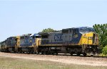 CSX 7350 leads a long line of locos out of the yard