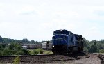 CSX 7323 leads a train towards the yard